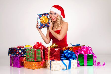 beautiful blond girl in christmas costume with gift photo