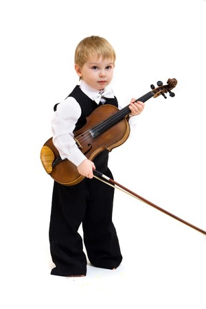 cute little boy with violin isolated on white