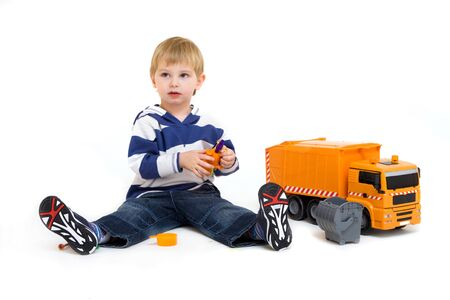 little boy playing with truck isolated on white photo
