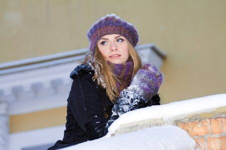 portrait of beautiful adult girl outdoor in winter photo