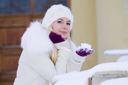portrait of beautiful adult girl outdoor in winter photo