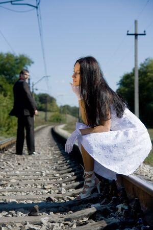sad love: portrait of young beautiful bride in summer outdoor