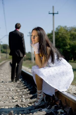 portrait of young beautiful bride in summer outdoor photo