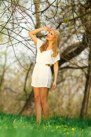 beautuful blond woman on meadow photo