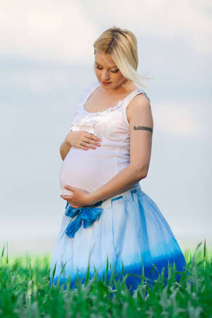 beautiful pregnant woman in sunny day photo