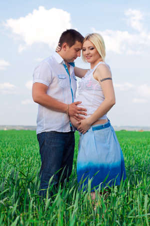 happy couple waiting baby in sunny day photo
