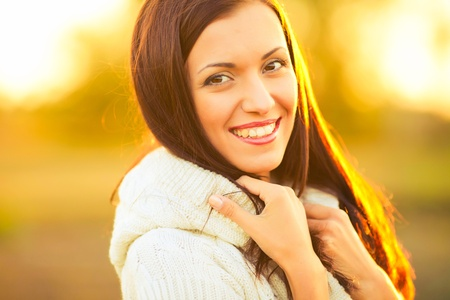 portrait of beautiful brunette young woman in countryside Stock Photo