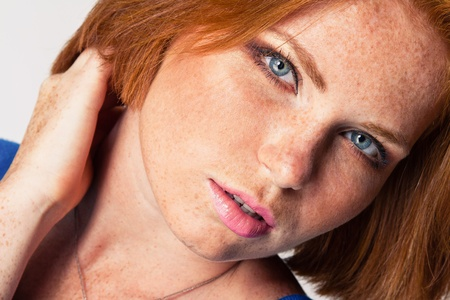 cute model in studio with red hair