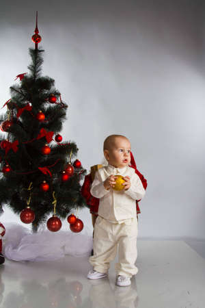 little baby boy with christmas decoration isolated on white Stock Photo - 12499181
