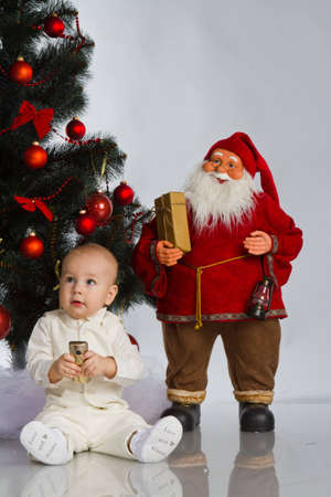 little baby boy with christmas decoration isolated on white Stock Photo - 12499240