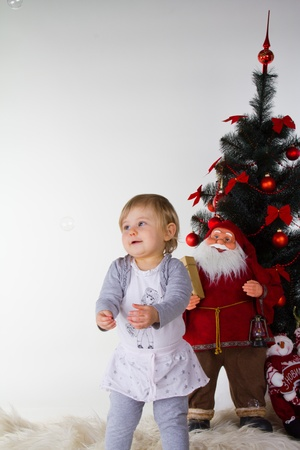little baby girl with christmas decoration isolated on white Stock Photo - 12498840