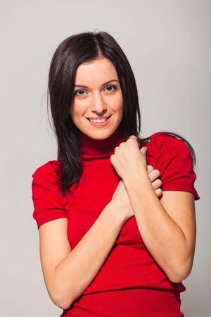 unsmiling: portrait of beautiful woman in studio Stock Photo