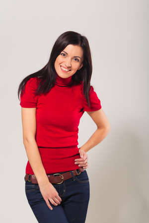 unsmiling: smiling young woman in studio