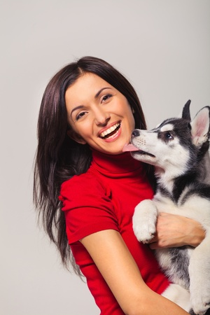 husky: young woman with siberian husky puppy Stock Photo