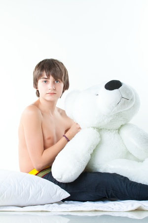 portrait of handsome guy with white bear isolated on white photo