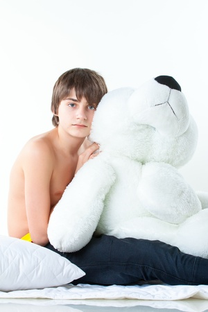 portrait of handsome guy with white bear isolated on white Stock Photo - 14415974