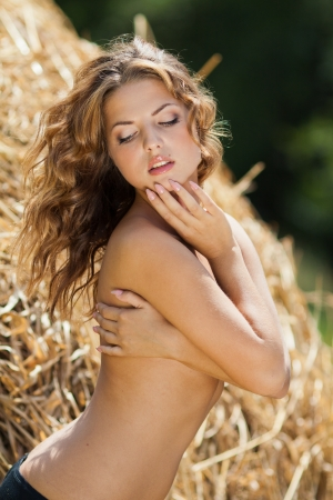 barn girls: portrait of beautiful young woman in countryside Stock Photo