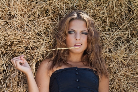 portrait of beautiful young woman in countryside photo