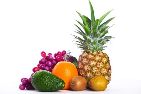 avocado, orange and pineapple isolated on white Stock Photo