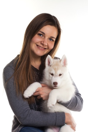 siberian husky puppy with owner photo