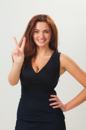 Beautiful casual young woman standing against white background Stock Photo