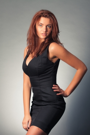 portrait of young beautiful woman in black dress photo