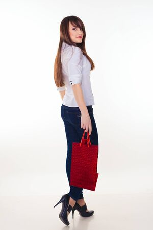 lovely woman with shopping bags over white Stock Photo - 16248955