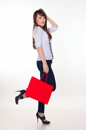 lovely woman with shopping bags over white Stock Photo - 16250489