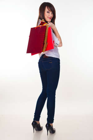 lovely woman with shopping bags over white Stock Photo - 16250497