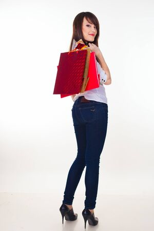 lovely woman with shopping bags over white Stock Photo - 16300174