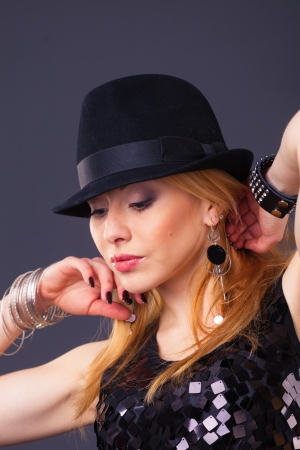 blond hair beautiful woman in black sequin dress on black background Stock Photo - 17383907
