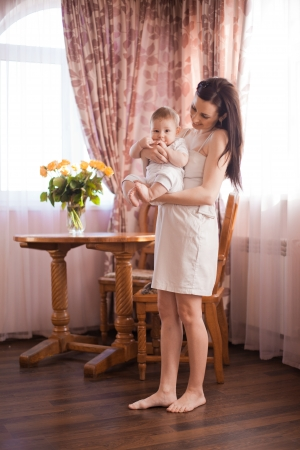happy mother and her baby Stock Photo - 17412526