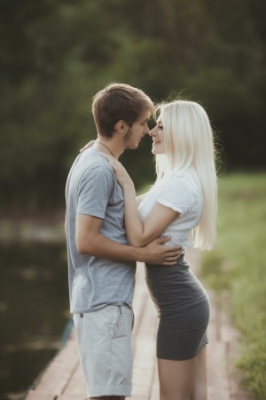 portrait of young couple in love outdoors photo