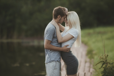 love kiss: portrait of young couple in love outdoors