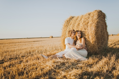 Image of young loving couple on wheat field