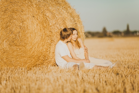 Image of young loving couple on wheat field photo