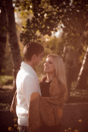 happy young couple in love outdoor in autumn photo