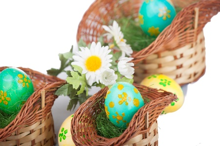 easter eggs in baskets isolated on white photo