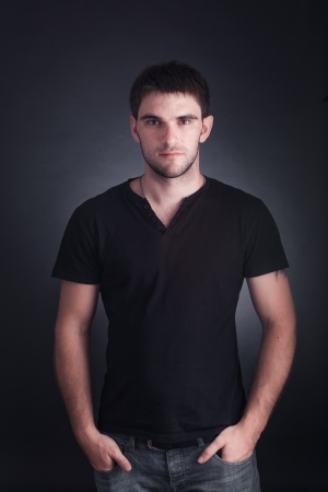 portrait of handsome guy on black background photo