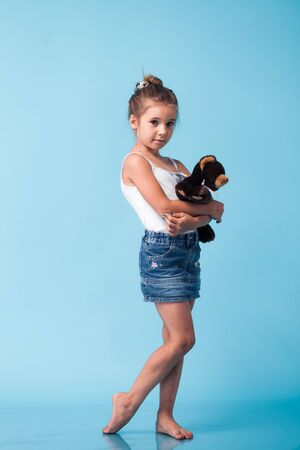 portrait of cute little girl on blue background photo