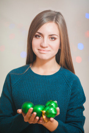 Young woman with christmas ball isolated on white photo