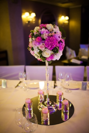 Celebratory tables in the banquet hall decorated with flowers