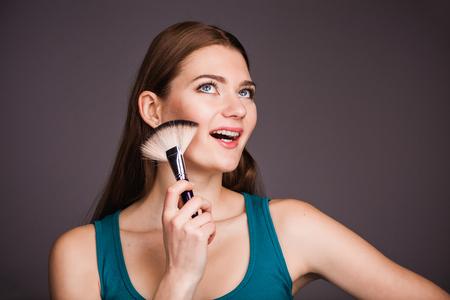 visagiste: Young visagiste holding brushe