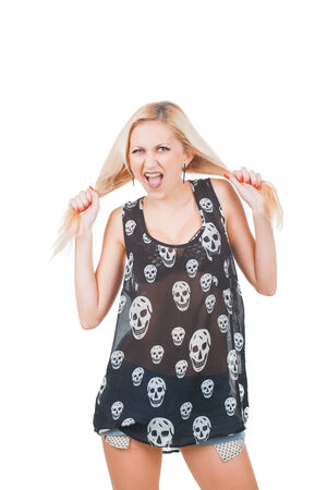 Screaming Fashion rock woman model in skull t-shirt isolated on white background photo
