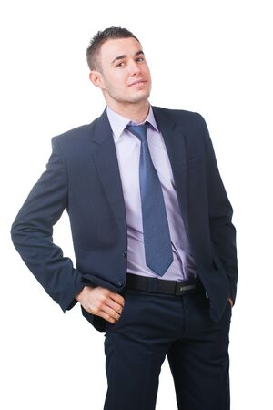 Confident modern businessman keeping his hands in trousers pockets isolated on white