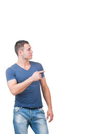 yuppie: Picture of attractive man pointing his finger. Studio shot Stock Photo
