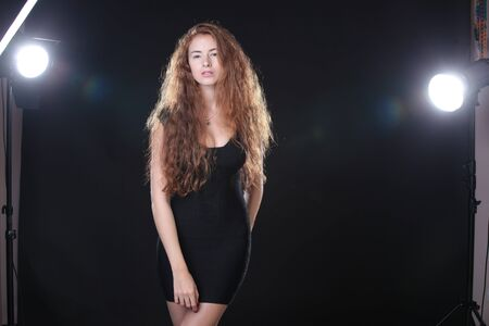 modeling: Pretty young woman modeling at camera in the studio Stock Photo