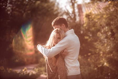 love hug: happy young couple in love outdoor in autumn