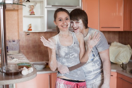 20   24: young happy couple cooking together in kitchen