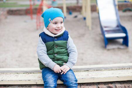 merriment: Active little boy on playground Stock Photo